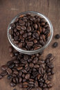 Close up of coffee beans on old wooden able Royalty Free Stock Images