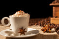 Close-up of coffee cup with whipped cream and star anise Royalty Free Stock Photo