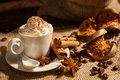Close-up of coffee with whipped cream and cocoa powder Royalty Free Stock Photo