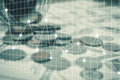 Close up coin and money with finance graph Royalty Free Stock Photo