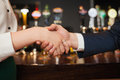Close up on colleagues shaking hands during meeting in a classy bar Stock Photos