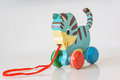 Close-up of a colorful, wooden, children toy kitten with a pulli Royalty Free Stock Photo