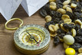 Close up of compass with trail mix Royalty Free Stock Photo