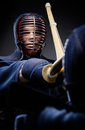 Close up of competition of two kendo fighters japanese martial art sword fighting Stock Images