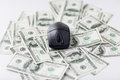 Close up of computer mouse and dollar cash money Royalty Free Stock Photo