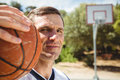 Close up of confident basketball player with ball Royalty Free Stock Photo