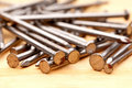 Close-up of construction nails on wood Royalty Free Stock Photo