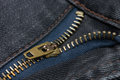 Close-up of a copper color zipper with black jeans Royalty Free Stock Photo