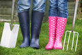 Close Up Of Couple Gardening Holding Spade And Fork Royalty Free Stock Photo