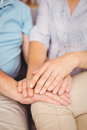 Close up of couple holding hands while comferting eachother Stock Photography