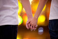 Close up of couple holding hands at night Royalty Free Stock Photos
