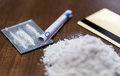 Close up of crack cocaine drug dose and money Royalty Free Stock Photo