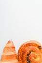 Close up on croissants, Danish pastry and chocolate and raisin filled pastries Royalty Free Stock Photo