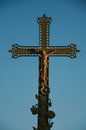Close-up of cross with blue sky at sunset, in the city center of Châteauneuf-de-Gadagne. Royalty Free Stock Photo