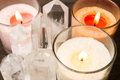 Close up of crystals and candles quartz aligned lighted color Stock Images