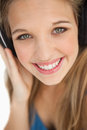 Close-up of a cute young blonde wearing headphones Royalty Free Stock Photography