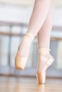 Close up of dancing legs of ballerina in pointes wearing white the hall Royalty Free Stock Photography