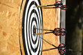 Close up of darts arrows being stuck in the target board Royalty Free Stock Photo
