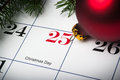 Close up of december th calendar on christmas day with evergreens and an ornament Stock Photography