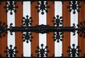 Close up decorated Gothic wooden and cast iron gate door