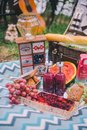 Design summer picnic in nature. On the plaid is a basket of food
