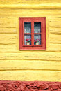 Close-up detail of colorful window on wooden cottage