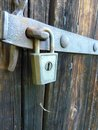 Old Vintage Padlock Lock on Old Wooden Barn Door Royalty Free Stock Photo