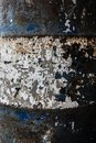 Close-up and detail of texture of a blue and white rusty fuel barrel Royalty Free Stock Photo