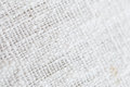 Close up detail view of a piece of linen cloth showing the pattern of the weave of a natural fabric Royalty Free Stock Photo