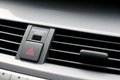 Close up detail of warning lights button and air vents inside a car Stock Image