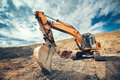 Details of industrial excavator working on construction site Royalty Free Stock Photo