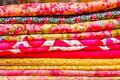 Close up of different fabric of different colors, fabric waiting for sewing clothes and other things, red, yellow fabric Royalty Free Stock Photo