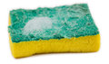 Close up of dirty sponge with soap suds closeup a used green and yellow against an isolated white background Royalty Free Stock Image
