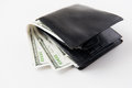 Close up of dollar money in black leather wallet Royalty Free Stock Photo