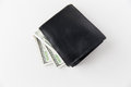 Close up of dollar money in black wallet on table Royalty Free Stock Photo