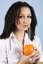Close up of drinking girl orange fresh Royalty Free Stock Photography