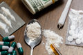 Close up of drugs, money, spoon and syringe Royalty Free Stock Photo