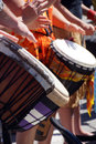 Close up of drumming by woman in bright clothes penticton british columbia canada Royalty Free Stock Image