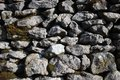 Close up dry stone wall with moss Royalty Free Stock Photo