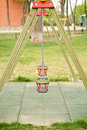 Close up of empty swing in a children play area at park Royalty Free Stock Photo