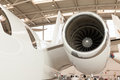 Close up of the engine on a corporate jet housing small twin passenger parked in hangar at an airport Royalty Free Stock Image