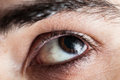 Close up of an eye closeup macro young man s wearing guyliner Royalty Free Stock Image