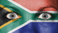 Close up of eyes with flag painted face south africa Royalty Free Stock Images