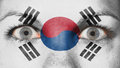 Close up of eyes with flag painted face south korea Royalty Free Stock Photography