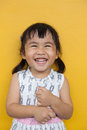Close up face of asian ked toothy smiling facial face with happi happiness emotion on yellow wall use for children lovely emotion Royalty Free Stock Images