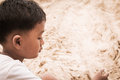 Close up of face cute little boy play sand Royalty Free Stock Photo