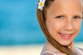 Close up face shot of blue eyed girl extreme cute smiling at seaside Royalty Free Stock Photo