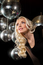 Close up face young blonde woman disco mirror ball hands Royalty Free Stock Photography