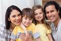Close-up of a family hugging in the kitchen Stock Images
