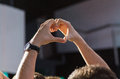 Close up of fan hands showing heart at concert Royalty Free Stock Photo